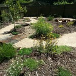 Native Garden with Dry Creek Bed and Recycled Railway Sleeper Bridges